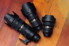 """The Nikon """"Holy Trinity"""" If your not a Nikon shooter you probably still know this term for their amazing glass!  14-24mm , 24-70mm, and 70-200mm zoom lenses...   Chances are if your a photographer you own all 3 or 1 of these and want the other two! :)"""