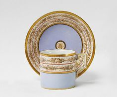 A neoclassical KPM porcelain coffee cup.