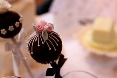 Sweet, delicate flowers on chocolate cake pops.