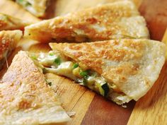 The keys to kickass quesadillas are mixing the filling right in with the cheese and using enough oil to get the tortillas to puff and crisp up golden brown.