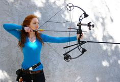 The lovely lady archer Virginia Hankins again...shooting PSE(?) compound bow