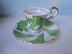UCAGCO China Made In Occupied Japan, Green, White and Gold Demitasse Cup and Saucer. Cup it is H. x across the rim. Saucer it is across the rim No chips, cracks or any damage. Normal wear at the gold rims due to age or use. Cup And Saucer, 1940s, Vintage Items, Tea Cups, Chips, Japan, Jade Green, How To Make, Gold