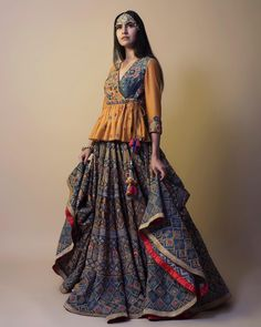 Tap into your ethnic roots adorning this stellar handcrafted lehenga by Samant Chauhan at the the next wedding soiree. We ship worldwide! Choli Blouse Design, Choli Designs, Lehenga Designs, Saree Blouse Designs, Garba Dress, Navratri Dress, Lehnga Dress, Indian Attire, Indian Outfits