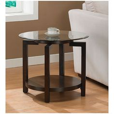 Wood and glass end table. Jut enough of both and it's inexpensive.