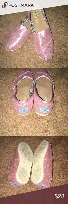 Tom sparkling pink shoes Toms sparkling pink size 7.5 w very cute and comfortable. There gently worn very cute Toms Shoes Flats & Loafers