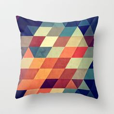 Want to start looking into getting a series of similar geometric cushions - nyvyr Throw Pillow by Spires - $20.00