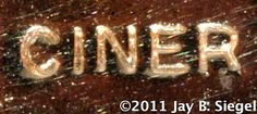 Ciner Ca. 1931-present / This is one of several similar marks used by Ciner on vintage costume jewelry. Ciner Jewelry Mark Used Prior to 1955.Ciner Manufacturing Company, founded in New York City in 1892 by Emanuel Ciner, originally crafted fine jewelry. The company moved into the costume jewelry business, for which it is well known and highly regarded, in the early 1930s. The company is still in business in New York under the direction of Patricia (Pat) Ciner Hill.