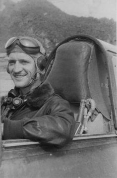 Dick Rossi in the cockpit of his P-40 Warhawk after flying non-stop from Kunming to Rangoon 1942.