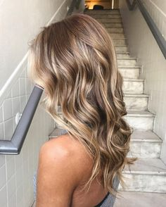 The shade hits the perfect balance between neutral and cool tones, marrying a brunette base with cool blonde in a way that will keep the color super low maintenance. #southernliving #haircolor #hair