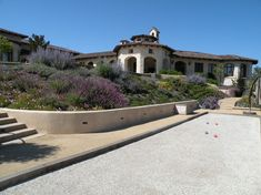 Bocce Ball Court for a Mediterranean Landscape with a Hillside Planting and Carmel Valley 01 (Design by Ron Herman) by Frank & Grossman Landscape Contractors, Inc.