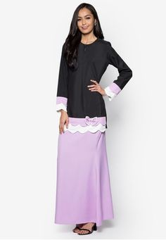 Baju Kurung Modern from Gene Martino in Black and Purple Gene Martino wants to make sure you look good when the occasion calls for traditional wear. Simple and feminine, this loose-fitting colourblocked design does so much for you with so little. A good purchase, we must say. Top - Polyester - Rou... #bajukurung #bajukurungmoden