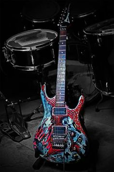 Joe Satriani Ibanez guitar with drumkit snare drum in background. Red white and blue colors merge and swirl on this colorful electric guitar. Unique Guitars, Custom Guitars, Vintage Guitars, Music Guitar, Cool Guitar, Ukulele, Guitar Diy, Joe Satriani, Guitar Design