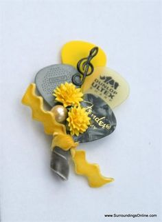 The perfect boutonniere for any musician or guitar player! This cheery guitar pick boutonniere corsage is a collage of several guitar picks Boutonnieres, Corsage And Boutonniere, Prom Flowers, Wedding Flowers, Real Flowers, Rocker Wedding, Our Wedding, Dream Wedding, Wedding Stuff