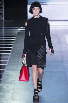 Louis Vuitton. Spring 2016 Ready-to-Wear. This look from Louis Vuitton's spring 2016 ready-to-wear collection reminds me of 90s grunge fashion. Throughout the 90s, platforms were in fashion. Another big thing in 90s grunge fashion is messy makeup, and dark clothing, which is why I picked this look. Vogue.com