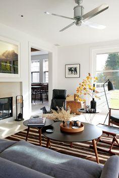bright walls, lots of contrast, slightly masculine feel, great ceiling fan