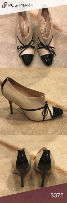 Manolo Blahnik classic nude and black mule pumps Gently worn. Nude leather with black patent toe. Fit like size US 7.5 Manolo Blahnik Shoes Heels
