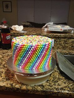 Sixlets cake @Elissa Dunbar Kinda like this… but a sheet cake and the sixlets on top...
