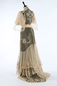 An embroidered lace bridal gown, circa 1905-1910.