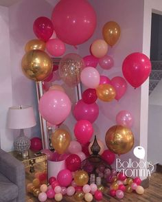 This baby shower went above and beyond with it's decor.  Shades of pink and yellow organic style balloon clusters behind the new mother's chair. It's a girl! | Balloons By Tommy | #balloonsbytommy