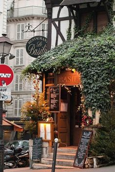 Restaurant Le Basilic, Montmartre, Paris, France, If you're staying in Montmartre, this little quaint restaurant is a treat. A 19th century small hotel, wood beams, brick and hearth are preserved. It's not haute cuisine but a reasonably priced very good French fare in a charming setting in the heart of the old village.