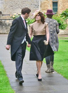 Princess Eugenie and her boyfriend Jack Brooksbank at the wedding of Charlie Colburn and Charlie Driver at St Mary's Church Bibury in Gloucestershire.