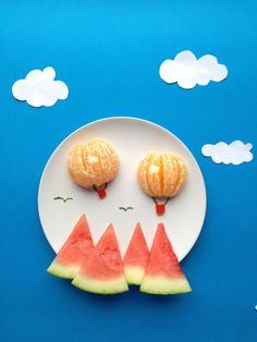 watermelon mountains with orange hot air balloons.