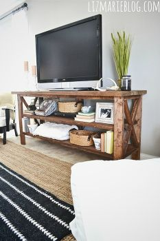 diy rustic tv console, electrical, home decor, painted furniture, rustic furniture, The TV stand is long works great in open floor plans or large living areas You can style this piece many different ways but we went for a cozy eclectic look feel