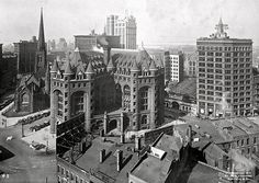 Downtown looking west circa 1919.... Trinity Church in the background well as Sullivan's Guarantee Building.... The two tall buildings are gone now but most interesting is the building with the curved roof.... Some kind of arena perhaps?