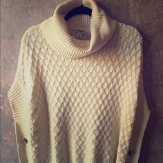 Old Navy turtleneck sweater with button accents Old Navy cream colored sweater with button accents on sides-looks great with a navy stripe shirt underneath-no sleeves-I am a size 6 and it fits large on me Old Navy Sweaters Shrugs & Ponchos