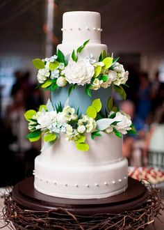 Bright and fun flowers with a hidden teir that has a different color for this wedding cake! Couture Wedding Cakes | Wilmington North Carolina