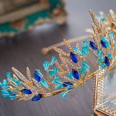 Order the Blue Tiara Crown hair accessory for a party or prom night. Shop for sparkling hair accessories for special occasions at the Apollo Box. Crown Hairstyles, Elegant Hairstyles, Bling Jewelry, Jewelry Accessories, Apollo Box, Storage Stool, Baroque Fashion, Tiaras And Crowns, Shaggy
