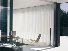 Silent Gliss Electric Curtain Tracks. Ceiling mounted track that creates natural waves in fabric.