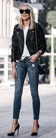 what to wear with a moto jacket : white top + bag + skinny jeans + heels