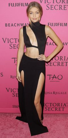 Gigi Hadid in a high-neck black gown slashed with extreme cut-outs and two thigh-high slits.