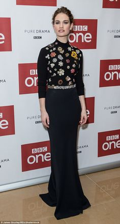 Sophisticated style: Lily James looked sensational in a black gown with colourful jewel em...