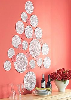 Cheap DIY Christmas Tree Decorations - paper lace doilies. More details: http://www.midwestliving.com/holidays/christmas/5-clever-and-cheap-diy-christmas-tree-alternatives/?page=4