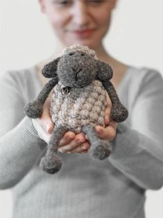 """You can create your very own adorable, woolly lamb! This crocheted lamb is packed with personality! The legs and head are felted, whereas the body and cap are left unfelted. This combination of texture is what adds to his character making him truly unique. Includes written instructions only, plus images for visual aid. Size: Approximately 5""""""""H when sitting. Made with medium (worsted) weight yarn and size E/4/3.5mm hook. Skill Level: Intermediate"""
