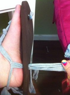 Put the shoes on and pull the string till its comfortable and looks good. Tie a double knot.