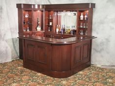 The Indy bar is the newest model to the line. It is similar to the Ivy League with a rounded front bar and upper soffet, making it a more modern style. Diy Home Bar, Modern Home Bar, Bars For Home, Basement Bar Designs, Home Bar Designs, Corner Bar, Corner House, Building A Home Bar, Wine Rack Bar