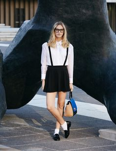 White button-down, mini black skirt, and loafers worn with socks