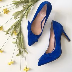 Blue Suede High Heel Pumps Soft suede. Classic high pump. Medium pointed toe. Artfully knotted and folded bow. 4 inch heel. Very little wear. Brand: Sole Society. Size 9.5. Note: both shoes have a slight wrinkle  inside at the heel, see pic.❤️ Shoes Heels