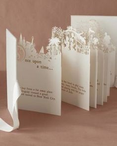"""""""Once in a while right in the middle of an ordinary life, love gives us a fairytale"""" These cards are so precious! Your guests will be quite impressed with these intricately cut invitations with your and your loved one's fairytale story printed inside! Love it!"""