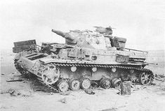 A Afrika Korps Panzer 4 left abandoned in the desert heat