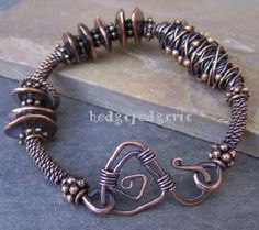 his beautiful bracelet combines twisted wire, Bali copper spacers, and Greek Mykonos™ ceramic cornflake-style beads that have been dipped in pure copper. A lovely rich patina enhances the incredible textures found in this bangle. Copper Jewelry, Wire Jewelry, Jewelry Art, Jewelery, Handmade Jewelry, Jewelry Design, Wire Earrings, Copper Wire, Jewelry Ideas