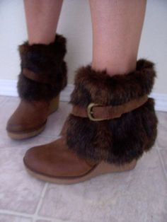 Faux Fur Boot Cuff DIY.......  I met a lady once at the Seattle Airport...she had a set of these..they were AMAZING looking...she double sided hers...one side was sheep skin  & the other side she used the fabric from an old serape!  & then had  fastened with rawhide strings.  She made them so that they were wearable with any ankle boot she wore...as well as her hiking boots.