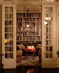 Un living como este necesito! Para guardar mis libros