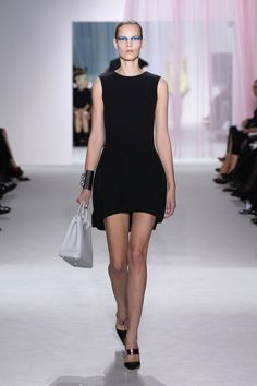 Dior Spring Summer 2013 Ready-to-Wear – Look 8: Black dress with wool/silk structured front and fluid pleated silk back. Discover more on www.dior.com #Dior#PFW