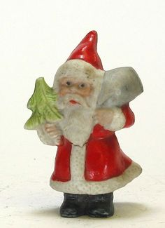 Antique German bisque miniature Santa figure with tree, bag with toys, very good