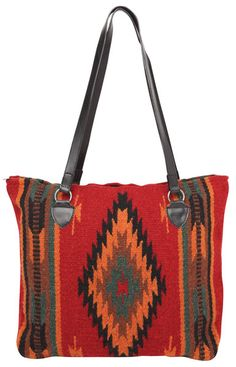 "Newly Designed, handwoven of imported 100% wool in classic Zapotec styles and rich colors.   These handcrafted handbags are a Southwest style favorite.  Zipper closure, fully lined inside, interior pocket.  Apx. 15"" x 18"""