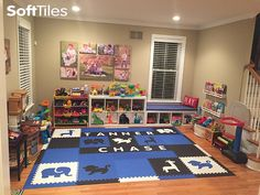 SoftTiles Safari Animals Playroom Foam Mats in Blue, Black, and White personalized with children's names. #playroom